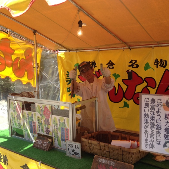 Man selling roasted gingko nuts.