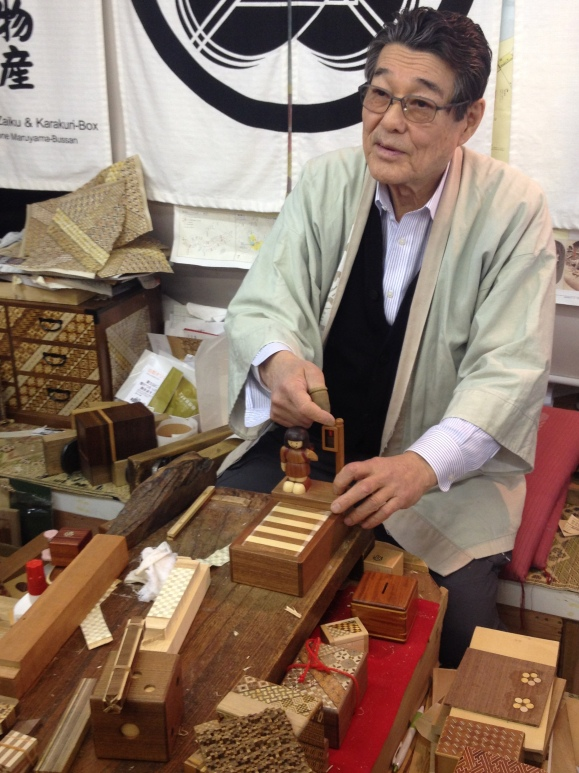 This man was showing us how the hundreds of pieces of wooden columns make up entire pieces.
