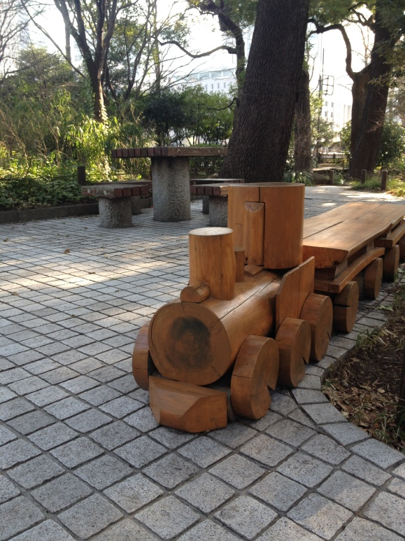 AND A CARVED OUT WOODEN TRAIN BENCH!