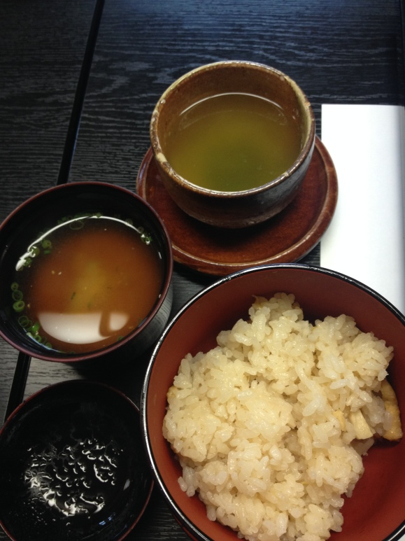 Green tea, red miso soup and bamboo rice