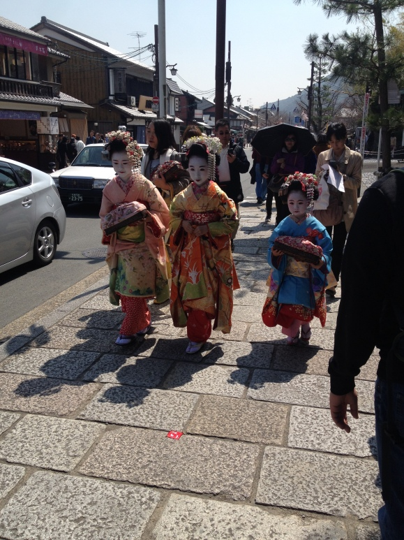 Little girls dressed like geishas.