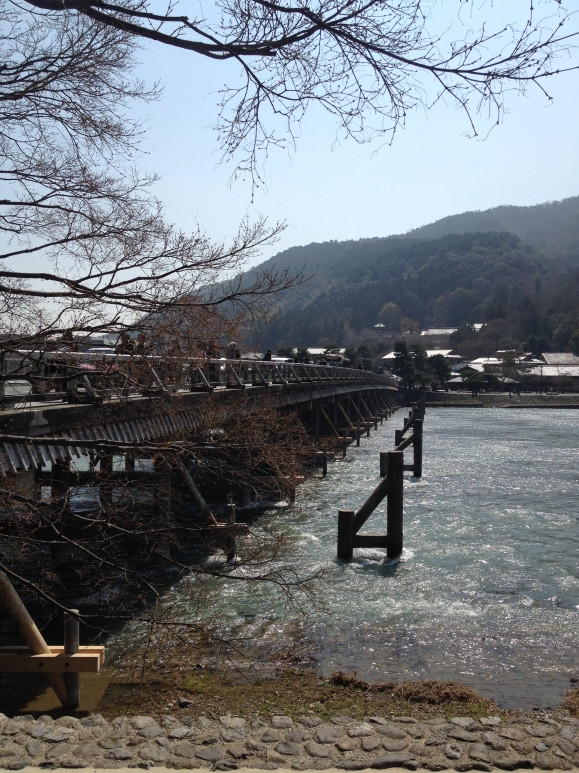 "Togetsukyo Bridge, or ""Moon Crossing Bridge,"" spans across the Katsura River"