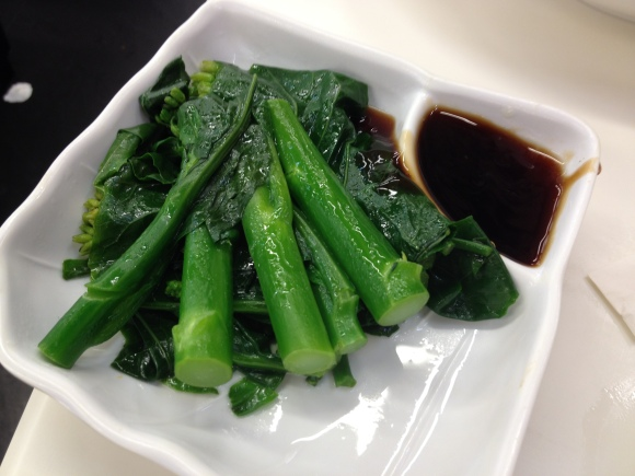 Gai lan, or Chinese broccoli, with a side of Hoisin sauce.